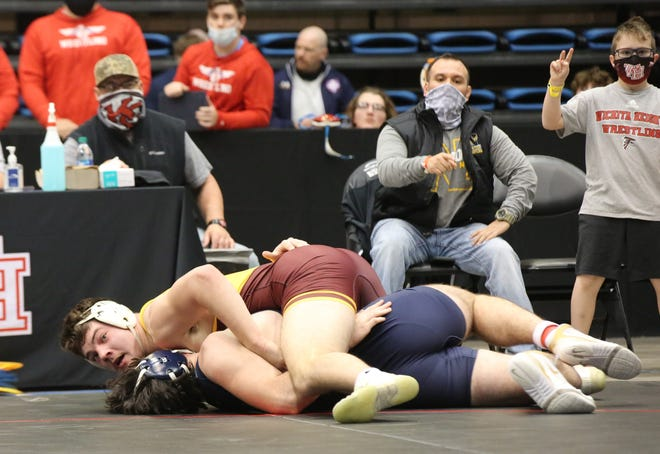 Hays' Gavin Meyers looks to see if he is credited with an overtime takedown of Mill Valley's Caden Casella at the edge of the mat in their 220-pound semifinal match Friday at the Class 5A state championships at Hartman Arena in Park City. After being awarded the takedown originally, it was waved off and Casella wound up getting one of his own to hand Meyers' his first loss of the season.