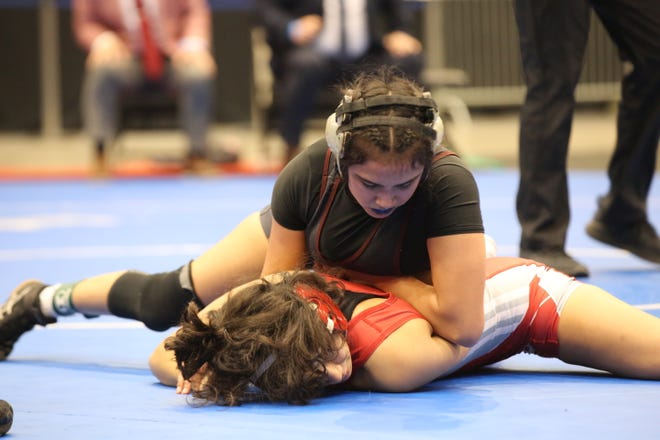 Hays sophomore Sarah Zimmerman tries to work Wichita North's Dialeen French in position to turn her to her back during Thursday's 109-pound state championship match at the Girls Division I State Tournament at Hartman Arena in Park City. Zimmerman took second after an 8-5 loss in the finals.