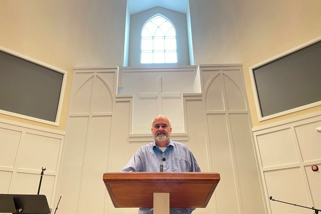 Pastor Jim Conrad stands in the Towne View Baptist Church on Feb. 18 in Kennesaw, Ga. In its 2021 meeting, the Southern Baptist Convention's executive committee voted to oust the church for allowing LGBTQ people to become members of its congregation.