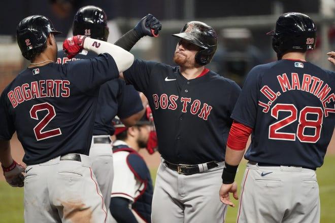 Red Sox base runner Christian Vazquez, center, celebrates after he hit a grand slam last season.