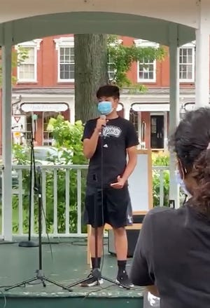 Enough Is Enough founder and CEO Aryan Kumar of Marlboro speaks during a protest last summer in Grafton.