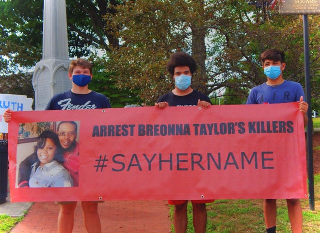 Members of Enough Is Enough lead a protest last summer at Shrewsbury Common.