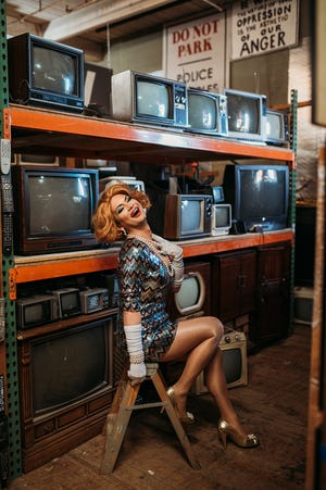 Joslyn Fox, from RuPaul's Drag Race, models at Westerman Restaurant Supply and Prop Warehouse in Worcester.