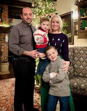 Anna (Dufault) Vaillancourt with her husband, Luke, and their sons, Charlie, soon-to-be 4, and Nate, 6.