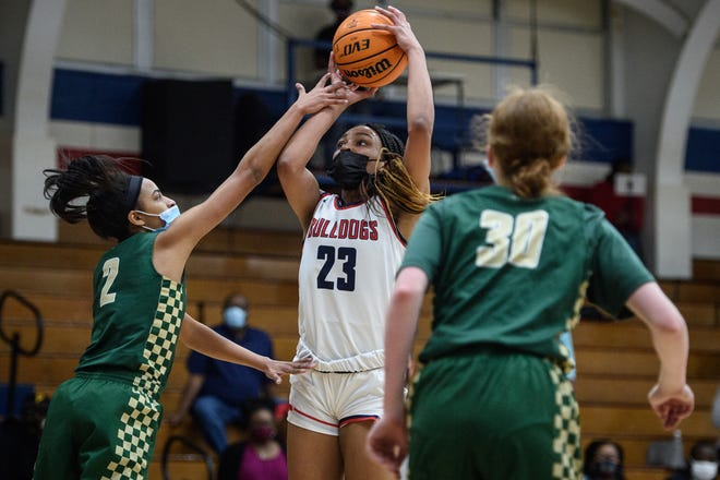 """Terry Sanford's Miya Giles-Jones said """"it was like a switch went off"""" in the second half as the Chargers mounted their comeback. She finished with 17 points, 10 rebounds and four steals to lead the Bulldogs."""