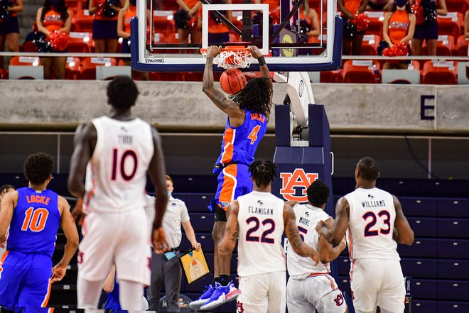Florida forward Anthony Duruji gets a dunk against Auburn on Tuesday at Auburn Arena.