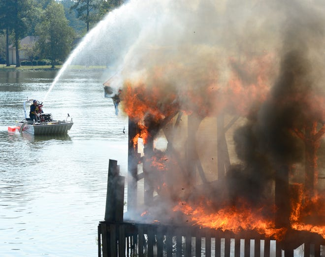 Rainbow City firefighters burn an old boathouse on Whorton Bend Road during a training exercise. The police and fire departments — with continuous service, 365 days a year — are Rainbow City's largest expenditures, and Mayor Joe Taylor says they'll be impacted if a move to ban occupational license fees in Etowah County succeeds.