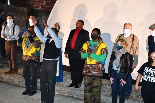 Sylvester Allen Jr. and the cast take a bow at the end of Thursday's inaugural performance. News of the performance is what inspired the Elon project.