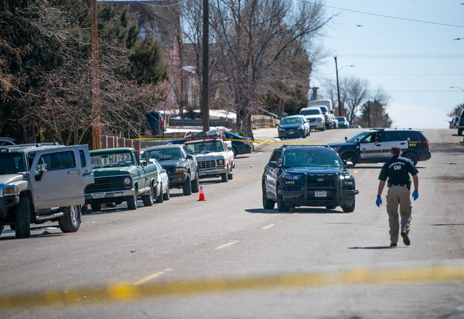 Pueblo Police investigate at the scene of a morning shooting on the 800 block of E. Evans Ave. on Friday February 26, 2021.