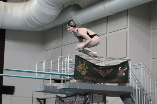 Colorado Mesa University's Kaylee Eakman prepares to go into the tuck position during a dive at the Grand Junction Invitational swimming and diving meet in Grand Junction last weekend.  Eakman, a Pueblo Central High School product, qualified for the NCAA Division II national swimming and diving meet. [Vince Smith/CMU athleticcs]