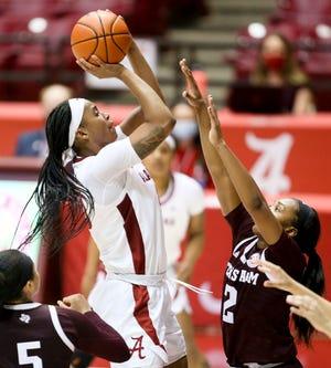 Alabama forward Jasmine Walker (40) shoots over Texas A&M guard Aaliyah Wilson (2) as the Crimson Tide women play the Aggies Thursday, Feb. 25, 2021, in Coleman Coliseum. [Staff Photo/Gary Cosby Jr.]