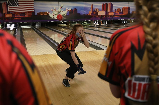 Worthington Christian's Hope Nyland reacts after rolling back-to-back strikes in the 10th frame during the Division II girls state bowling tournament Feb. 26 at Wayne Webb's Columbus Bowl. The Warriors finished eighth.