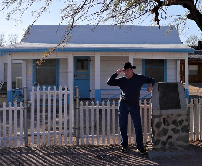 John in front of the cottage once owned by Wyatt Earp and his wife, Josephine in Vidal, Calif.