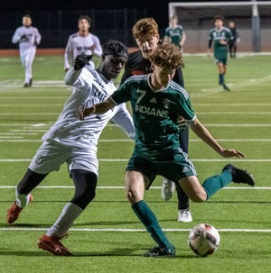 Waxahachie junior Landon Gilmore (7) controls the ball during a February home match against Mansfield Lake Ridge. Gilmore has been named the Utility Player of the Year in District 11-6A by a vote of coaches in the district, leading a list of honors for the Indians.