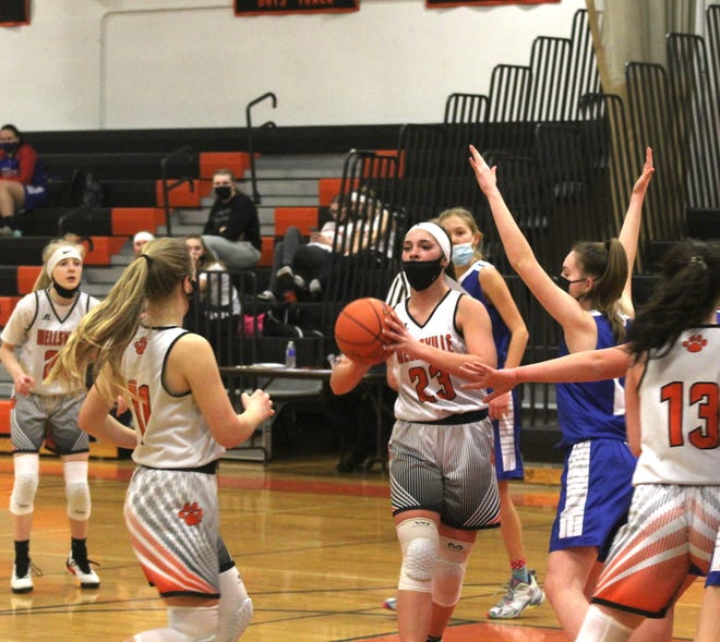 Wellsville's Kaylee Coleman (23) looks to make a pass to Jaylynn Mess (11) in Thursday night's home win over Cuba-Rushford.