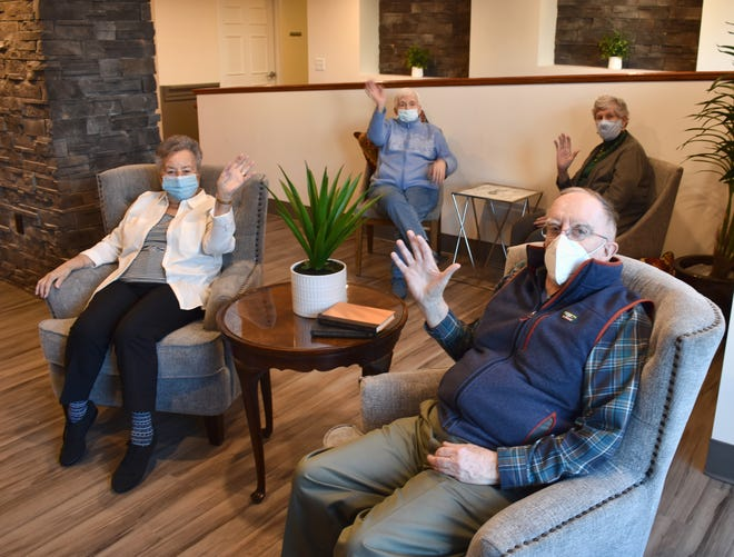 Pictured, from left: Residents Florence Fitzsimmons, Sally Casey, Maureen Copithorne and Joe Keating in one of the Courtyard Suites common areas.