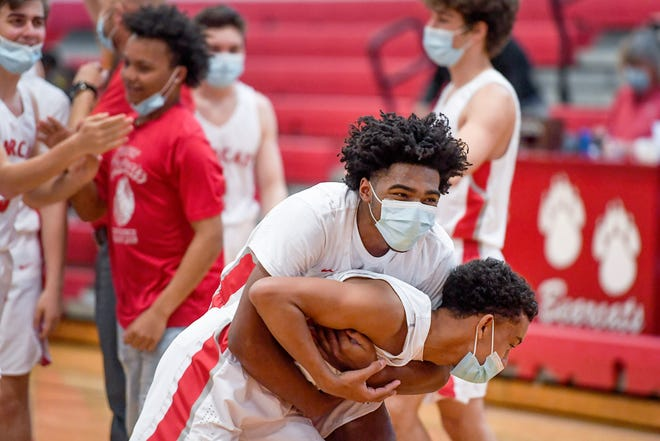 Dwight Canady hugs Keenan Wilkins after Hendersonville defeated Atkins in the playoffs on Thursday night at Hendersonville Middle School.