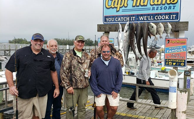 The Incentive party is shown with the fish they kept for eating after catching 20 cobia, plus kingfish, triggerfish, red snapper and grouper offshore Sebastian Inlet.  From left is Danny Hunter, Tom Taylor, Joe Horschel, John Mordas, and Tom Murphy who organized the trip with Capt. Bruce Alcock (walking in background) out of Capt. Hirams Resort in Sebastian. It was non-stop fishing action. They hooked up with a total of 30 cobra, plus the other species.