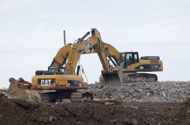 Bulldozers work in the rubble where part of Wynford's old building has been demolished.