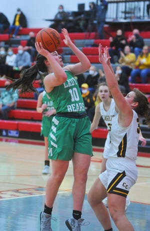 Margaretta's Kylie Leibacher shoots over Colonel Crawford's Allison Teglovic in the paint.