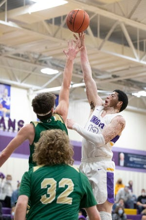 Unioto's Tayvion Galloway shoots over Athens to score two of his 18 total points during a Division II sectional final game at Unioto High School on Feb. 25, 2021. Unioto defeated Athens 59-28.