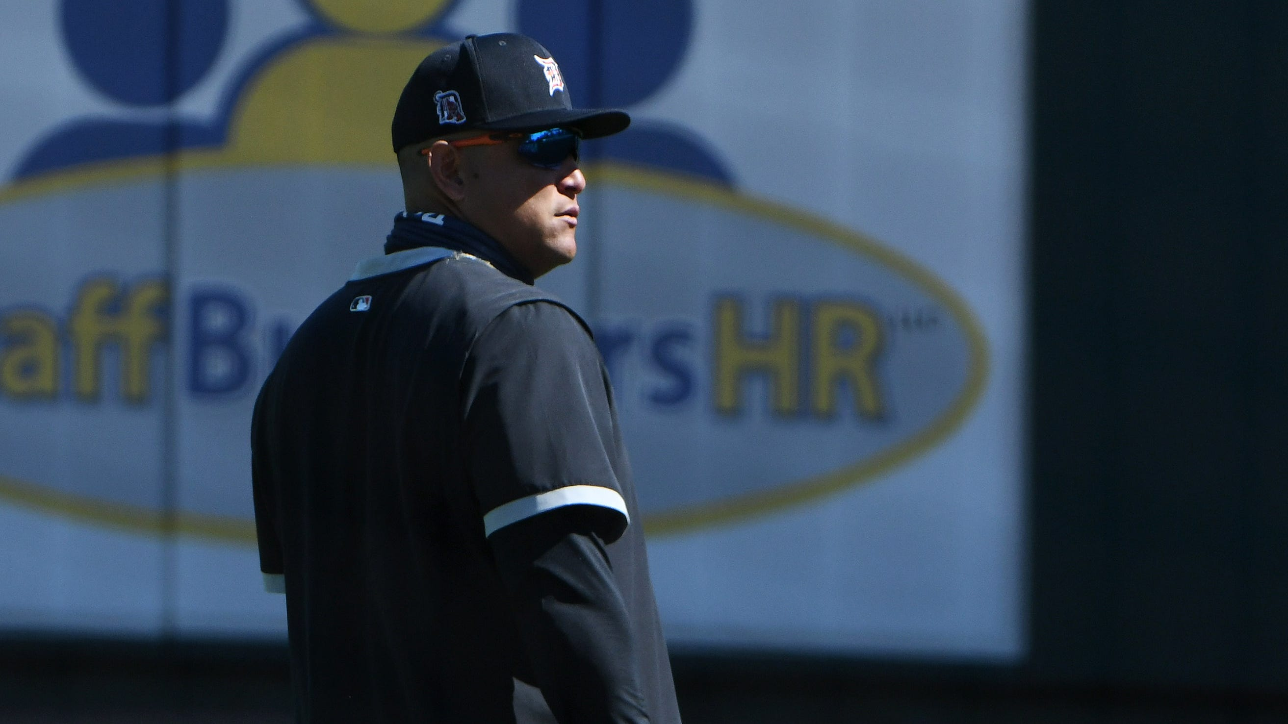 Miguel Cabrera walks in the outfield near the end of the Detroit Tigers workout.