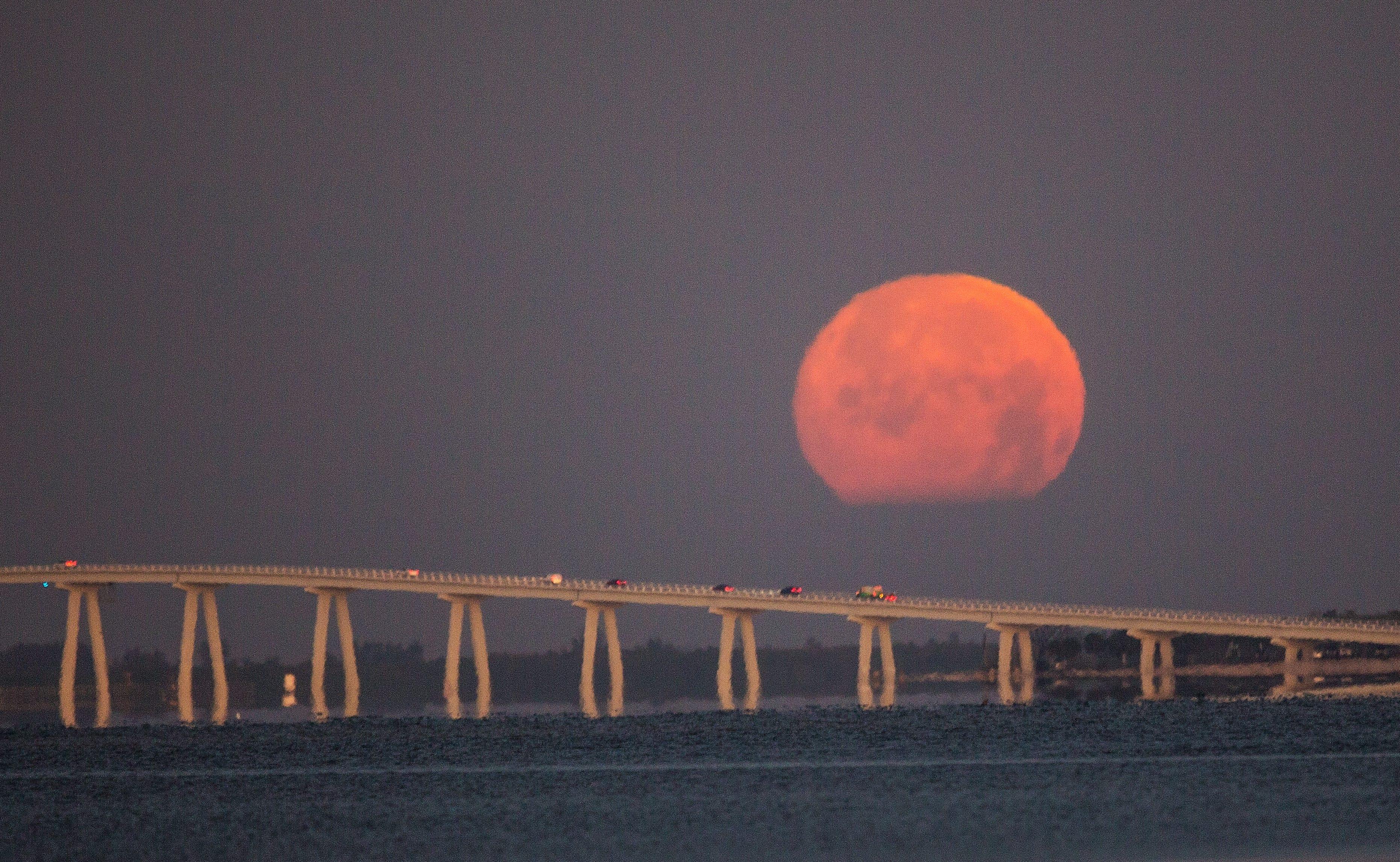 Snow moon sets over the Sanibel Causeway 2