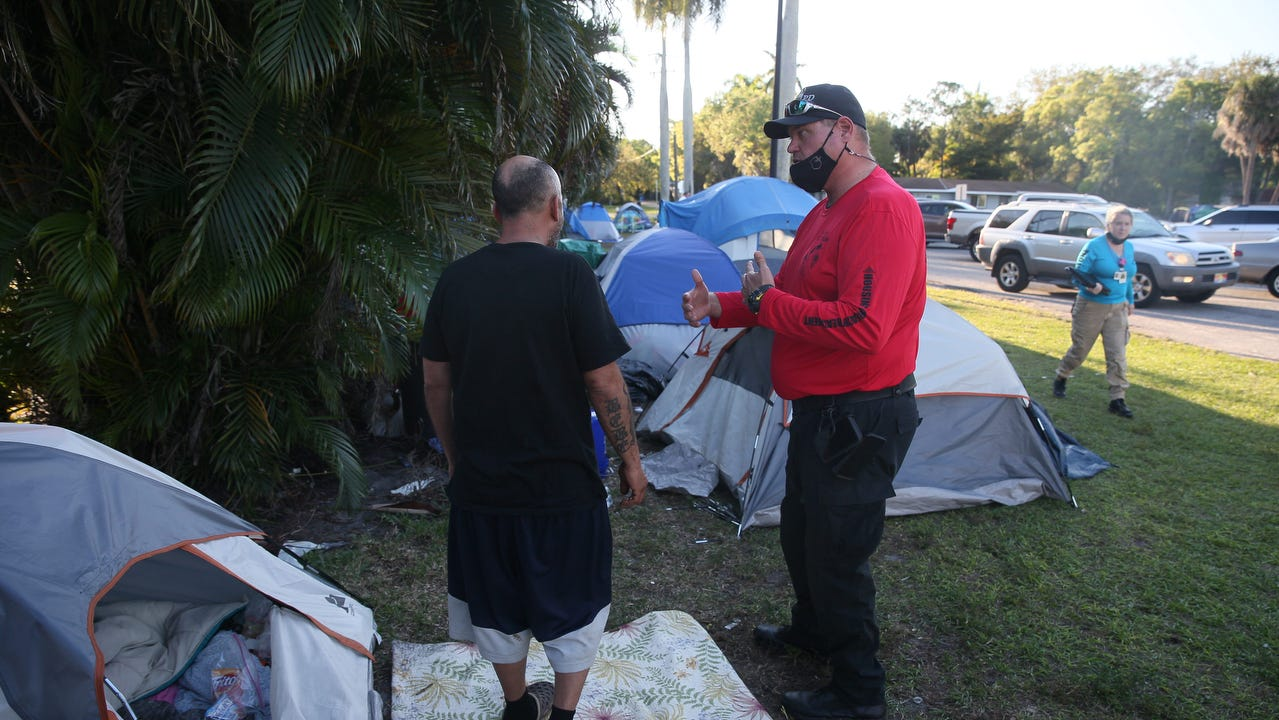 Members of the HOT team met at Lions Park in Fort Myers this week to offer services to help get the homeless population off the street. The population of homeless has swelled at the park over the last several months.