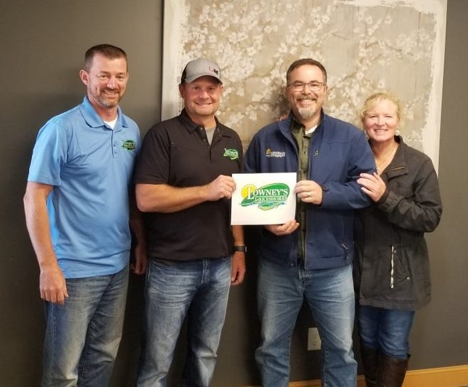 Lowney's Landscaping Center, Inc. of Appleton has bought Lakeshores Landscape & Design, Inc. of Carlsville, which is now called Lowney's Lakeshores Landscaping & Design of Door County. Shown are, from left, Aaron Vosters, general manager, and Joe Lowney, owner of Lowney's; and John and Theresa Meredith, previous owners of Lakeshores, who are continuing with the company.