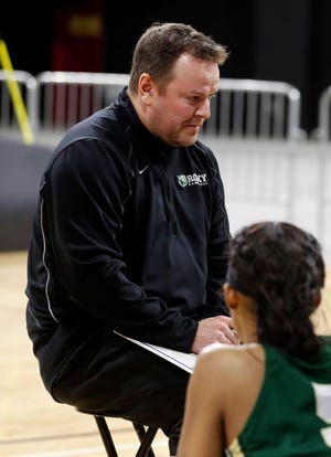 Rocky women's basketball coach Wes Keller talks to the team during a timeout in a game on Jan. 11, 2020.