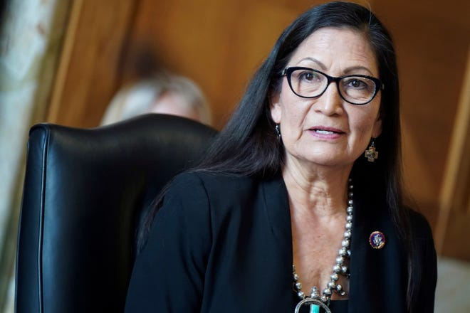 FILE - In this Wednesday, Feb. 24, 2021, file photo, Rep. Debra Haaland, D-N.M., testifies before a Senate Committee on Energy and Natural Resources hearing on her nomination to be secretary of the Interior, on Capitol Hill in Washington. Haaland would become the first Native American to lead the Interior Department that oversees tribal land, national parks, endangered species, and oil and gas development on public lands. (Leigh Vogel/Pool via AP, File)