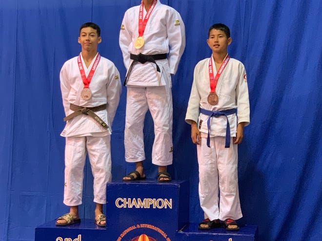 Keane Escaba, center, was the USA Judo champion in the 50kg weight class following his performance at a tournament in 2019.