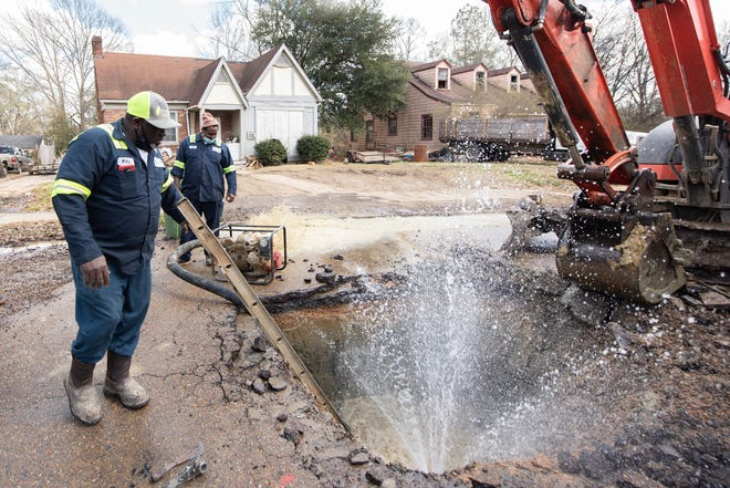 Water shoots out of a broken six-inch water main north of the intersection of Claiborne Avenue and St. Charles Street, where the W-10 crew from the city of Jackson Water Maintenance Department pumps out the water so they can fix the break Friday, Feb. 26, 2021. Water Maintenance Department crews are working throughout the city to fix breaks to help get water restored to residents after the recent winter storms that hit the area.