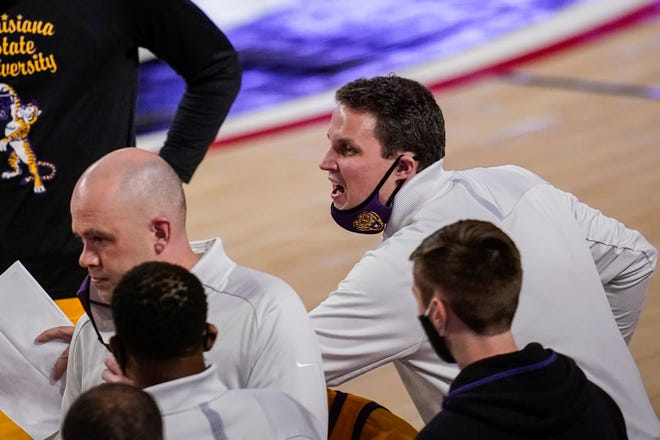 Feb 23, 2021; Athens, Georgia, USA; LSU Tigers head coach Will Wade (center) reacts to his team during a timeout against the Georgia Bulldogs during the second half at Stegeman Coliseum. Mandatory Credit: Dale Zanine-USA TODAY Sports