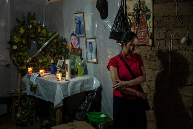 Ingrid Tomás at home in Comitancillo, Guatemala, at her brother's altar.