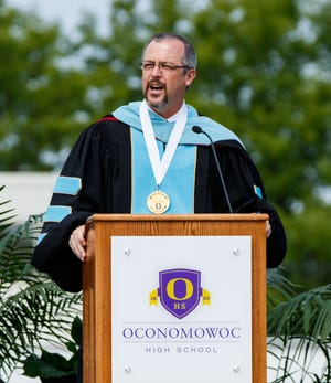 Oconomowoc Area School District Superintendent Roger Rindo welcomes graduates, family and friends to the 2016 Oconomowoc High School commencement ceremony on June 11, 2016. Rindo is leaving in July to become the superintendent of the Reedsburg School District.