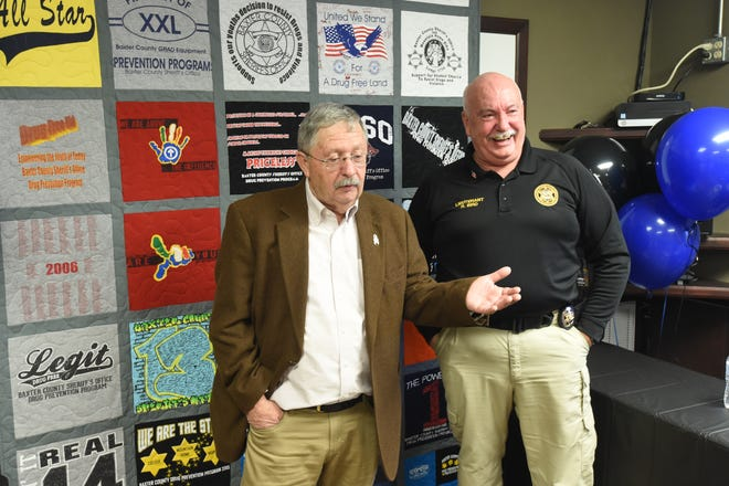 Retiring Lt. Ralph Bird, right, laughs as former Baxter County Sheriff Benny Magness, left, tells a story Friday at the BCSO during Bird's retirement party. Bird served the BCSO for more than 25 years.