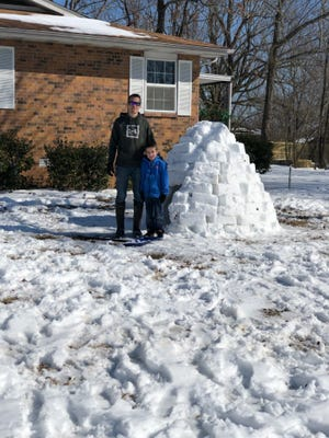Tim Steinhaus and his son, Trakker, used the recent snowstorm to construct an igloo. The pair used plastic bins to pack and shape the snow into building blocks.