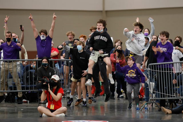 Fans cheer during TSSAA state wrestling tournament championships at the Chattanooga Convention Center on Thursday, Feb. 25, 2021, in Chattanooga, Tenn.
