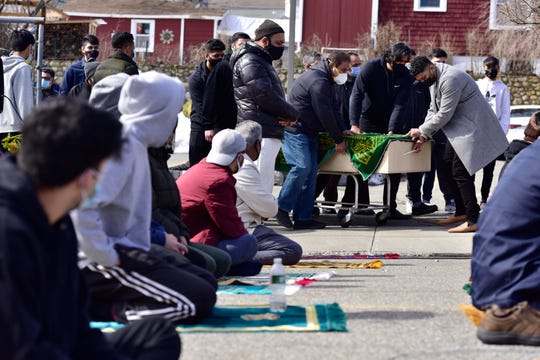 Mourners gather for the funeral of Warda B. Syed and her son, Uzair Ahmed, at the Jam-e-Masjid Islamic Center in Boonton, N.J. on Friday Feb. 26, 2021. Syed and her son drowned in the Rockaway River at Grace Lord Park on Tuesday.