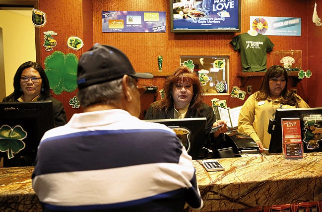Players Club supervisor Muriel Nez, center, assists a patron on March 11, 2015 at Northern Edge Casino in Upper Fruitland. The Navajo Nation Gaming Enterprise will receive supplemental funding to help as casino closures continue.