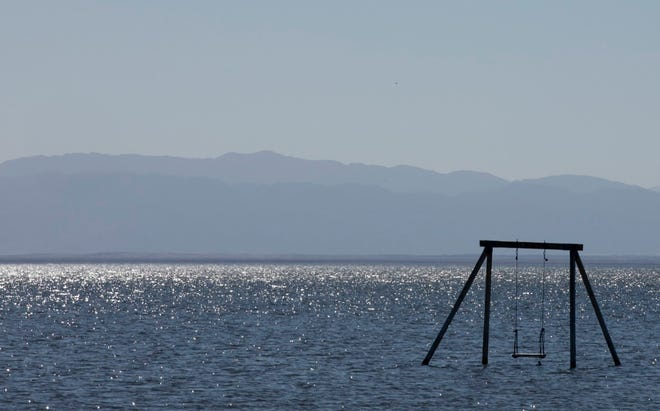 A swing set stands alone in the Salton Sea on Feb. 4, 2021.