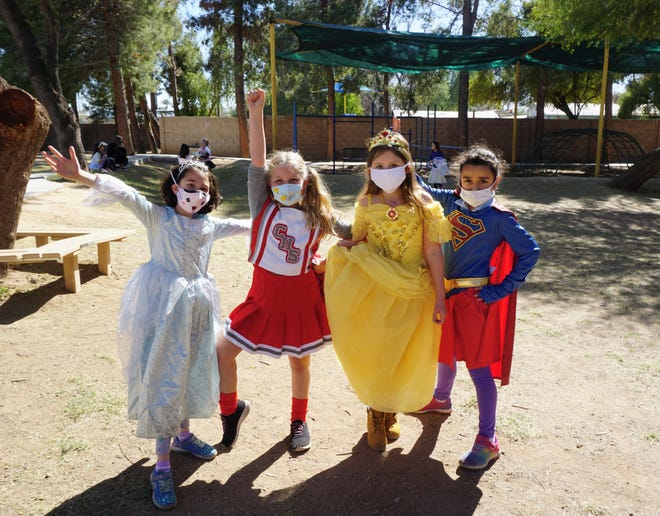 Phoenix Hebrew Academy students Yael Bangiyev, Ruby Stanlis, Bella Hyatt and Dahlia Musaev, from left to right, pose for a photo at the school Purim carnival Feb. 24, 2021.