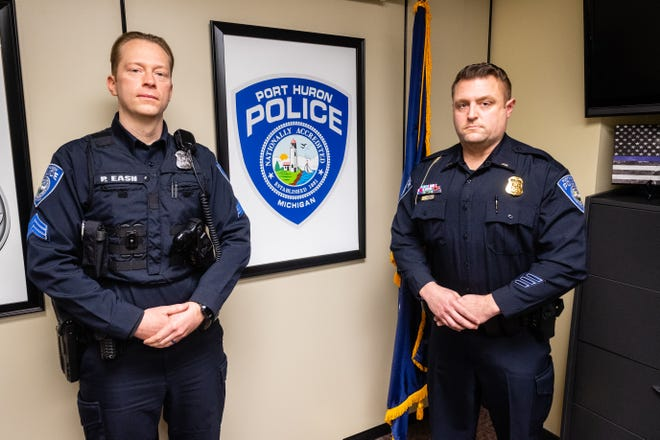 Port Huron Police Sgt. Patrick Eash, left, and Lt. Jason Barna pose for a portrait Thursday, Feb. 25, 2021, in the department's office in the Municipal Office Center in Port Huron. The two officers entered a burning building Sunday morning to rescue a resident who was trapped inside.