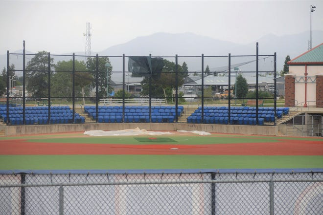 A look at a baseball diamond and bleachers inside Big League Dreams in Redding from the parking lot where the fields remained closed on Monday, May 11, 2020. Big League Dreams will reopen March 6.