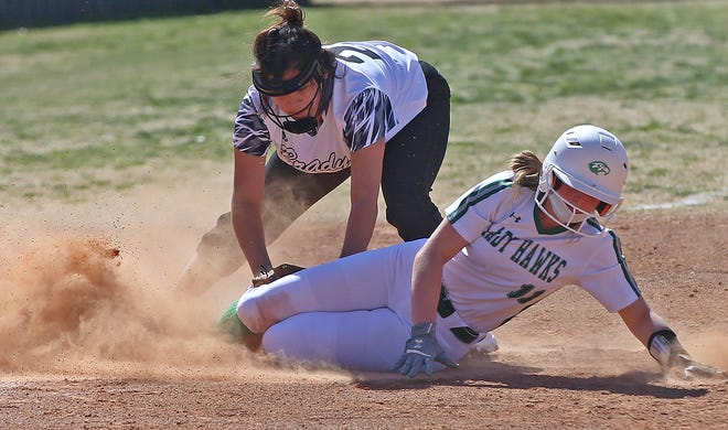 Loren Temples, right, slides into third base for Wall during a game against Brady on Friday, Feb. 26, 2021.