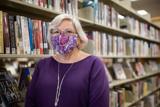 Debra Sears, LeRoy Collins library director, poses for a photo in the nonfiction section Friday, Feb. 26, 2021. The Eastside Branch Library is closing for a day on April 17 for pest control treatments and a pop-up library will be open.