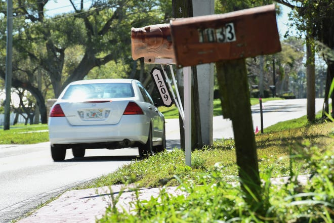Traffic passes through the area surrounding the 1200 block of South Indian River Drive on Thursday, Feb. 25, 2021, in Fort Pierce. On Feb, 7, a 32-year-old woman was killed in a car crash in the 1200 block of Indian River Drive. The scenery of South Indian River Drive comes with a price. Trees and power poles are often extremely close to the pavement, trees, bushes and shrubs can block the view of oncoming traffic around curves, and most of the roadway does not have sufficient shoulder space for roadside emergencies.