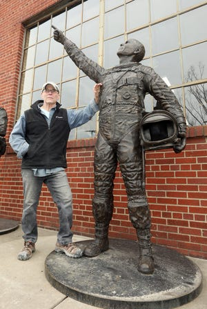 Zanesville sculptor Alan Cottrill's depiction of John Glenn is heading to the statehouse. He is seen with the first copy of the statue, which is displayed outside his studio in downtown Zanesville.
