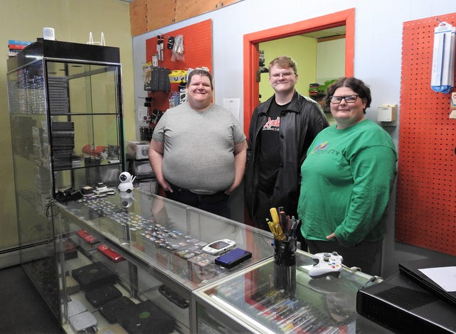 Kevin Kreider, owner of EJ Video Game Exchange, with his children EJ and Angela. The store is named for his son, who plans to take over the shop one day. It has more than 1,400 unique video game titles. It also sells video game systems, accessories, DVDs and Blu-rays and trading card games.
